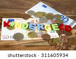 Small photo of The german term for child allowance in colored letters