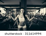 beautiful fit woman working out ... | Shutterstock . vector #311614994