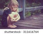 portrait of sad blond little... | Shutterstock . vector #311616764