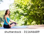 Woman On A Yoga Mat To Relax I...
