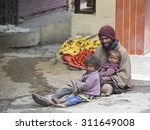 Small photo of LEH, INDIA - JUNE 29, 2015: Unidentified poor Indian beggar family on street in Ladakh. Children of the early ages are often brought to the begging profession.