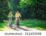 Smiling Couple On Bicycles In...