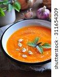 vegetarian pumpkin soup with... | Shutterstock . vector #311654309