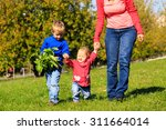 mother with little daughter and ... | Shutterstock . vector #311664014