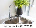 water tap with sink in  modern... | Shutterstock . vector #311670950