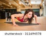 beautiful young woman... | Shutterstock . vector #311694578