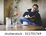 man reading a book during... | Shutterstock . vector #311701769