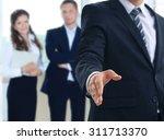 a business man with an open... | Shutterstock . vector #311713370