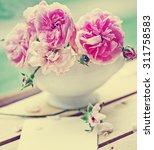 beautiful roses on desk wooden... | Shutterstock . vector #311758583