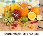 sweet breakfast on wooden table | Shutterstock . vector #311765630
