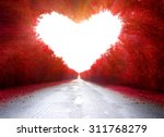 Stock photo road to love trees in the shape of a heart 311768279