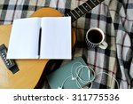 Acoustic Guitar With  Book And...