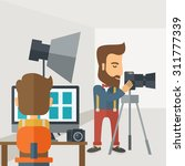 a photography studio with a... | Shutterstock .eps vector #311777339
