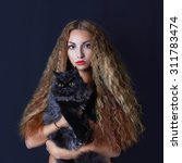 Stock photo halloween mysterious girl with black cat beautiful young witch woman 311783474