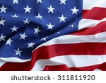closeup of ruffled american flag | Shutterstock . vector #311811920