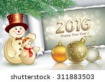 christmas card with snowmen in... | Shutterstock .eps vector #311883503