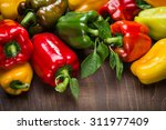 Colored Peppers On A Wooden...