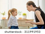 mother scolds her child | Shutterstock . vector #311991953