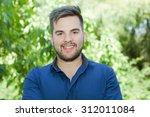 happy young casual man outdoor... | Shutterstock . vector #312011084
