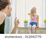 mother scolds her child | Shutterstock . vector #312042770