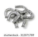 small horse shoes made of tin ... | Shutterstock . vector #312071789