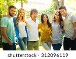 happy friends standing outdoors  | Shutterstock . vector #312096119