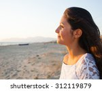 beautiful young teenager with a ... | Shutterstock . vector #312119879