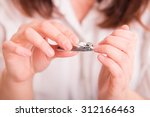woman cutting nails using nail... | Shutterstock . vector #312166463