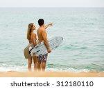 happy surfers couple standing...   Shutterstock . vector #312180110