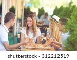 four cheerful young friends... | Shutterstock . vector #312212519