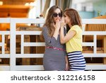 two girl friends whispering... | Shutterstock . vector #312216158