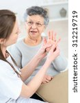 checking an old lady's hands | Shutterstock . vector #312219719