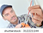 electrician snipping a wire | Shutterstock . vector #312221144
