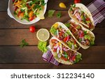 mexican tacos with meat  beans... | Shutterstock . vector #312234140