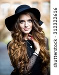 beautiful stylish young woman ... | Shutterstock . vector #312322616