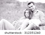 pregnant woman with her husband ... | Shutterstock . vector #312351260