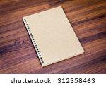 blank notebook mock up on wood... | Shutterstock . vector #312358463