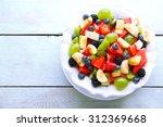 Fresh Fruit Salad On Wooden...