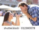 proposal of a woman asking... | Shutterstock . vector #312383078