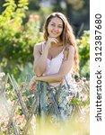 outdoor portrait of happy long...   Shutterstock . vector #312387680