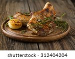 Small photo of Pork loin fried on wooden table