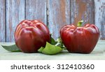 red peppers with leaves | Shutterstock . vector #312410360
