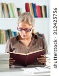 student learning in library | Shutterstock . vector #312425756