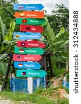 Small photo of AEC country name on multicolor wood signboard decorate on side the road