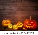 Pumpkins On Wooden Background...