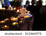 flaming candles at the funeral... | Shutterstock . vector #312464573