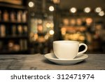 cup of coffee on wooden table... | Shutterstock . vector #312471974