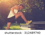 stretching after jogging. | Shutterstock . vector #312489740