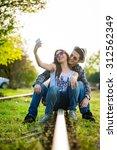 selfie with smartphone  happy... | Shutterstock . vector #312562349
