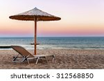sunbed  straw umbrella on... | Shutterstock . vector #312568850
